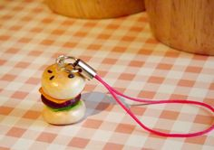 Polymer burger charm on a pink mobile phone by KooshyJewellery