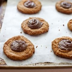 A flourless (gluten-free!) peanut butter cookie with a dab of nutella & a sprinkle of kosher salt.