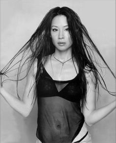 Lucy Liu, this is what I want to see. Raw, pure, beauty. No push-ups, no fake stuff. Just pure woman!