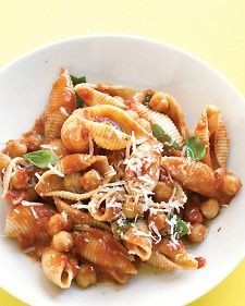 Pasta with Chickpea-Tomato Sauce - Martha Stewart Recipes.  Did this last night!  I used tomato sauce instead of crushed tomatoes and I added spinach.  Was delicious and simple and easy!