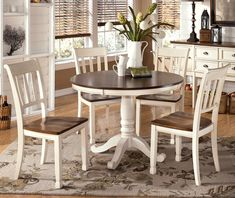 Create Warm Dining Setting with Rustic Round Dining Room Tables : Chic Rustic White Dining Table With Brown Table Top Combine With White Painted Wooden Pedestal And Chairs Designed With Brown Sooen Seats Complete With Cream Rug On The Brown Floor