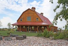 Barn Home with beautiful open porch!    www.sandcreekpostandbeam.com  https://www.facebook.com/pages/Sand-Creek-Post-Beam-Traditional-Post-Beam-Barn-Kits/66631959179