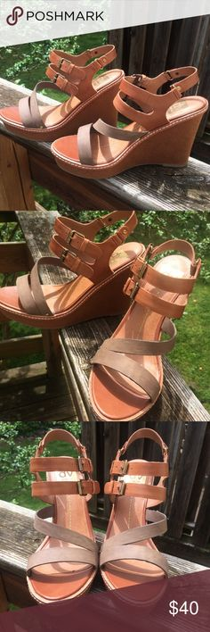 Just In! Dolce Vita Wedges Dolce Vita brown and tan wedges with cream thick stitching, peep toe, and double Buckle straps. Shoes are in excellent condition. Size 9. Dolce Vita Shoes Wedges
