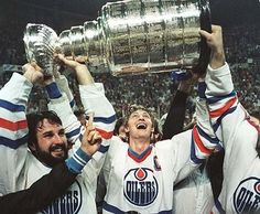 Wayne Gretzky and a bearded Paul Coffey hoist the Stanley Cup on May 19 It was the first Stanley Cup championship for the Edmonton Oilers. Photo by Mike Pinder Edmonton Journal Hockey Teams, Ice Hockey, Sports Teams, Hockey Rules, Hockey Sport, Nhl Jerseys, Lord Stanley Cup, Wayne Gretzky, Stanley Cup Champions