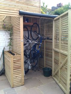 Taller, narrower shed to store bikes upright - takes up less room in the garden. : Taller, narrower shed to store bikes upright - takes up less room in the garden. Bicycle Storage Shed, Outdoor Bike Storage, Bike Shed, Shed Storage, Storage Ideas, Wall Storage, Diy Storage, Vertical Bike Storage, Garage Bike