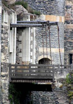 Château d'Angers, Angers, Loire Valley, Maine-et-Loire, France.... http://www.castlesandmanorhouses.com/photos.htm ..... Photo shows a spectacular drawbridge controlling entry. The Château d'Angers was founded in the 9th century by the Counts of Anjou. It was expanded to its current size in the 13th century. It is strategically located by the river Maine. Open to the public, the Château d'Angers is home of the Apocalypse Tapestry.