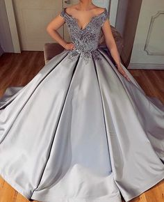 This dark pewter satin ball gown can be created for any formal occassion. If you are searching for platinum silver colored #weddingdresses This is a great option. We also can make inexpensive #replicadress too that are less than the original. For pricing go to www.dariuscordell.com