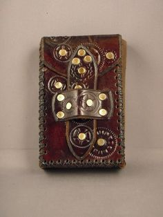 I want to make a Steampunk casing for my little camera. This is a good idea, but with holes for the lens and buttons.