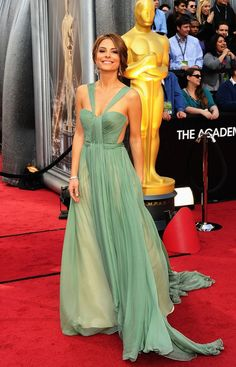 Maria Menounos Evening Dress  Sure, sure, the Oscars are meant for honoring the greatest achievements of the movie industry, but every fashionista knows it's all about the dresses. Who can forget Gw...