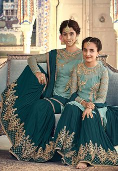 Turquoise Two Tone Embellished Gharara Palazzo Suit very intrinsic designer embroidery over its fancy net top paired with matching ghera embroidered georgette palazzo bottom and embellished chiffon dupatta. Pakistani Wedding Outfits, Bridal Outfits, Pakistani Dresses, Indian Dresses, Indian Outfits, Wedding Lehanga, Pakistani Clothing, Pakistani Bridal, Indian Clothes