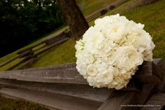 white hydrangeas, ranunculus and roses for bridal bouquet