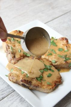 Pan-fried pork chps smothered with buttermilk gravy