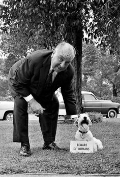 Alfred Hitchcock with a dog, 1956.