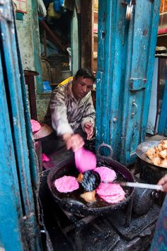 Let the local food tickle your funny bone you! Like this pink pancake stall..  In Kathmandu, Nepal   #Nepal