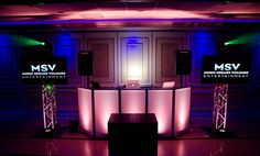 """The Flat Screen Package  • 5 hours of service • Jazz Cocktail Music Setup • Professional DJ • Illuminated DJ Frontboard • Two 60"""" LED Flat Screen TVs • Two Intelligent Moving Head Lighting Fixtures • Professional Sound System (wireless microphones) • Video Visuals • Custom made slide Show Displayed During Dinner • Ceremony Photo's Displayed During The Reception. Price: $2199"""