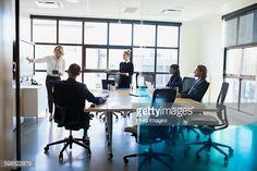 ストックフォト : Businesswoman leading meeting in conference room