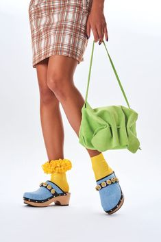 Fashion's obsession with nostalgia continues for spring with square toes, mom mules, clogs, scrunchies, anklets and more on foot. 90s Shoes, Ugly Shoes, Clogs Shoes, French Luxury Brands, Official Shoes, Snakeskin Boots, Spring, Crocs, Shoe Trend