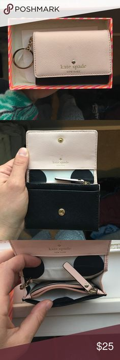Kate spade small wallet Light pink and black anal Kate Spade wallet with box and tag, kate spade is written in gold on the front and there there is a gold keychain that you can hide inside or have out. There is a small hardly noticeable black smudge on the front(see last photo). kate spade Bags Wallets