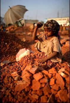 A young girl working in a brick crushing factory in Dhaka Bangladesh Child exploitation or simply working so the family can eat Our first world problems are so lame in co.
