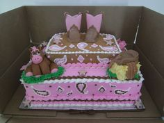Cowgirl cake! 1st birthday! --Horse, boots, saddle (on haybale) , and cowboy hat (behind haybale) are all made of fondant! The rest is all buttercream icing! :)