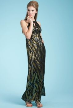 Trina's Long Caliente Dress defines glamour. Its halter neckline flows into an empire waist that creates the most slimming of silhouettes. Made of Trina's spectacular Gold Leaf Chiffon.