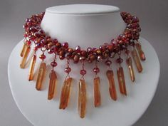 NoGlitzNoGlory.  This necklace is one of a kind and will definitely turn heads! Made from freshwater pearls, Chinese crystal, redwood beads, copper chain, Miyuki seed beads and Quartz crystal sticks