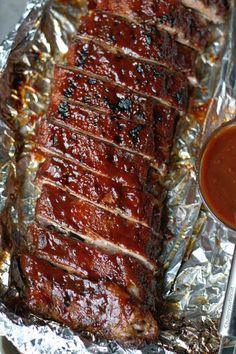 Oven Baked BBQ Ribs Pork Ribs 2 racks pork loin ribs about 6 lbs 1 jar barbecue sauce Dry Rub ½ cup brown sugar 1 tablespoon garlic powder 1 tablespoon onion powder 1 teaspoon salt 1 tablespoon chili powder 2 teaspoon cumin 2 tablespoons smoked paprika Easy Oven Baked Ribs, Ribs Recipe Oven, Baked Bbq Ribs, Baking Ribs In Oven, Baked Spare Ribs, Best Ribs Recipe, Oven Cooked Ribs, Slab Of Ribs Recipe, Meat Recipes