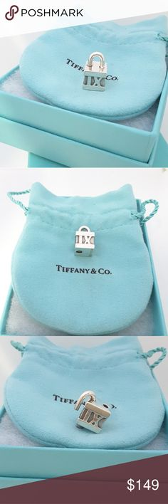 Tiffany & Co Roman Numeral Square  Padlock Charm Tiffany & Co Sterling Silver Roman Numeral Square Padlock Charm Pendant    The padlock pendant that is perfect for any necklace or bracelet that you already own!  The padlock opens and closes so can be taken on or off any bracelet or necklace  No longer in production, it is a wonderful Tiffany piece to start or add to your collection.  The item is hallmarked and guaranteed to be 100% authentic.  Hallmarks: Tiffany & Co. 925  Pre-owned in very…