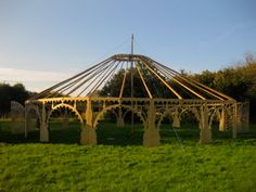 Hand cut decorative wooden frame, forming arches to this circular yurt style tent.
