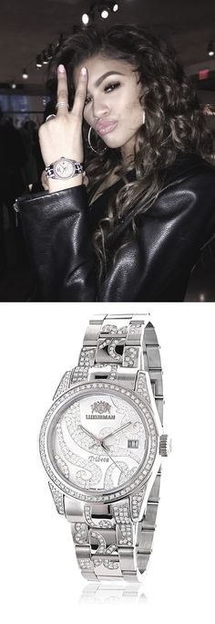 Zendaya with Luxurman Tribeca diamond watch.  is Platinum Plated and features 3 carats of genuine diamonds, including diamond bezel and designer diamond band. This ladies diamond watch has Swiss movement, dial paved in sparkling stones and a date display window at a 3 o'clock position. This stylish womens diamond Luxurman watch comes with two extra leather interchangeable straps in different colors and makes a perfect present for any occasion.
