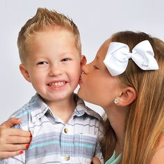 Sibling photo idea: All you need is love  Celebrate the bond between brothers and sisters with this adorable sibling photo idea. Share the love by adding your images to a holiday card or canvas print.