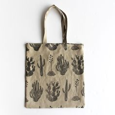 """***WILL SHIP ON JANUARY 16TH.***Pure linen tote bagSand colorMedium-weight linenHand sewnScreen printed cactus design in black inkInspired by our Cactaceae linocut printAbout 14"""" wide by 16"""" tall"""