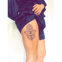 hamsa thigh tattoo.