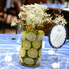 Easy DIY centerpiece - This is so simple and yet so classy.  Depending on when we tie the knot, I think I would change out the fruit though and maybe have this at the gift table or something like that.