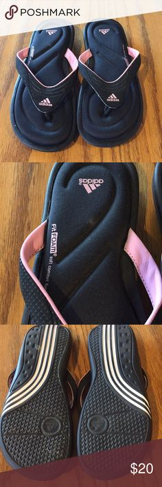 Adidas Flip Flops Pink and black size 7 Adidas flip flops/sandals. Good condition I wore them last summer. I accept reasonable offers! adidas Shoes Sandals