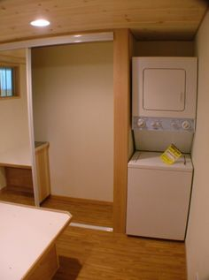 stackable washer/dryer in the bedroom--right next to the closet. Now doesn't that make perfect sense? dodge-spacious-park-model-tiny-cabin-on-wheels-by-rpc-007