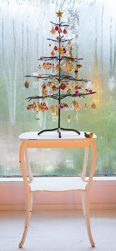 Ornamental....metal tree with glass ornaments.