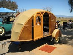 Dean Tennis built this amazing little wood-frame and canvas 'teardrop' to be pulled behind his restored Model A Ford