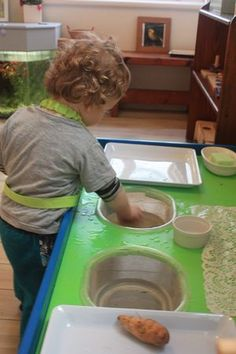 Washing Potatoes. Put your toddler to work in the kitchen.  Keep them busy while teaching practical life skills.