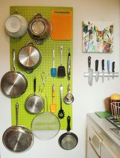 kitchen: wall storage with color...the peg board never gets old