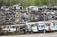 A trailer park damaged by the wildfires is seen in Fort McMurray, Alta., on Monday, May 9, 2016. THE CANADIAN PRESS/Ryan Remiorz