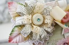 """""""Loopy"""" strips from old book pages ad lace make a beautiful flower or bow"""