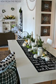 This creative design is a brilliant DIY project that will bring some rustic charm to your dinner table. You'll need black canvas duck cloth, white craft paint, a small paint brush, and a yardstick.  See more at View from the Fridge.