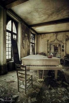 Abandoned, the piano and mirror in the back