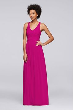 In bright pink Begonia, this mesh bridesmaid dress is a flattering favorite with a fitted bodice and crisscross back. Discover more long bridesmaid looks at David's Bridal.