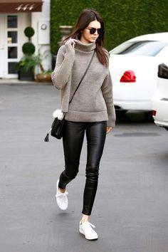 On Jenner: Elizabeth and James Watts Aviator Sunglasses ($195); 1-01 Babaton sweater; Saint Laurent bag; Kenneth Kole Kam Sneakers ($120).