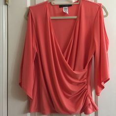Orange/dark peach cold shoulder crossover top Peach passion cold shoulder top with flouncy sleeves!!!  You can dress this one up or down!!!Poly/ spandex Tops Blouses
