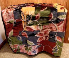 Ready to help keep you warm, this plush velour throw has a pretty leaf pattern.