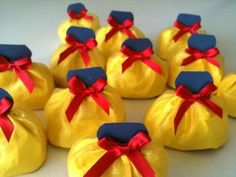 Yellow tissue paper cut into circle and wrapped up holding with a red bow for princes party
