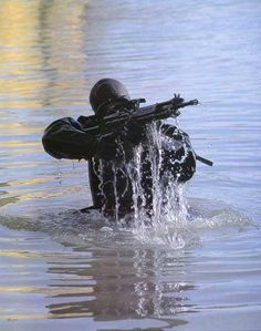 Wearing diving gear and armed with M-4 carbines, members ...  |Navy Seals Emerging From Water